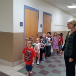 Teacher with students in hallway