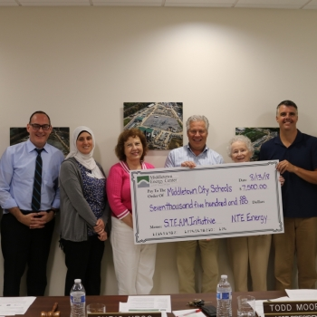 Group with giant check