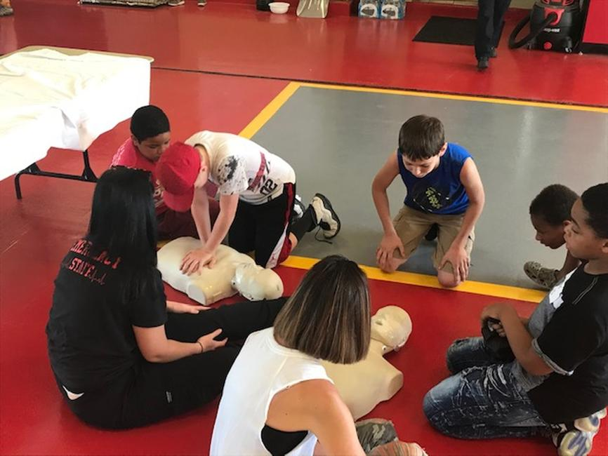 Students performing CPR