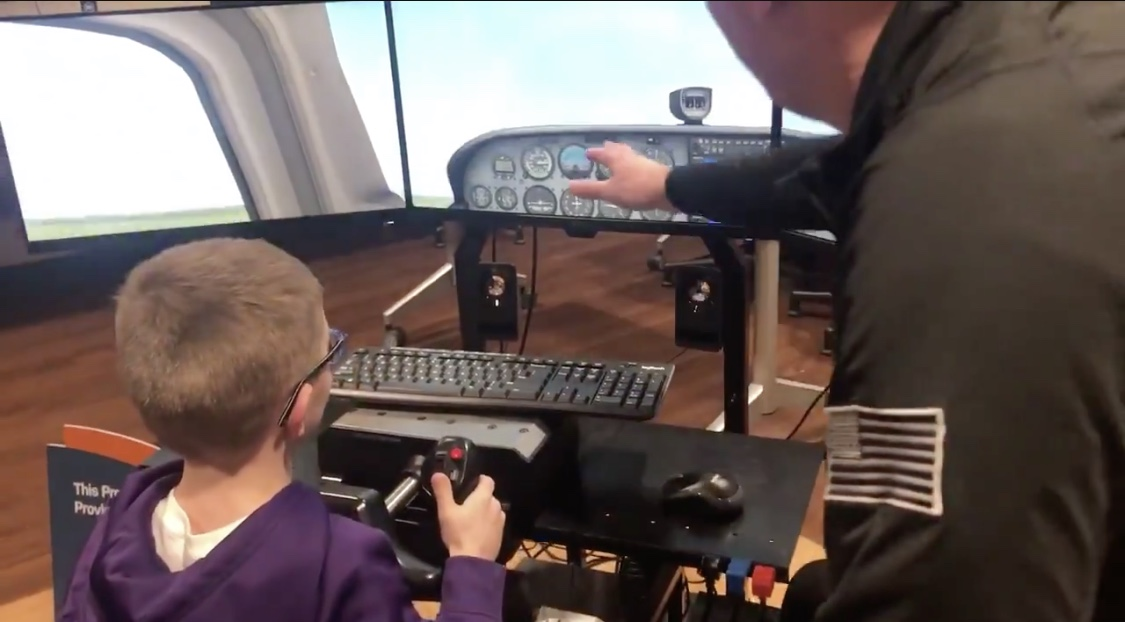 Student flying a flight simulator