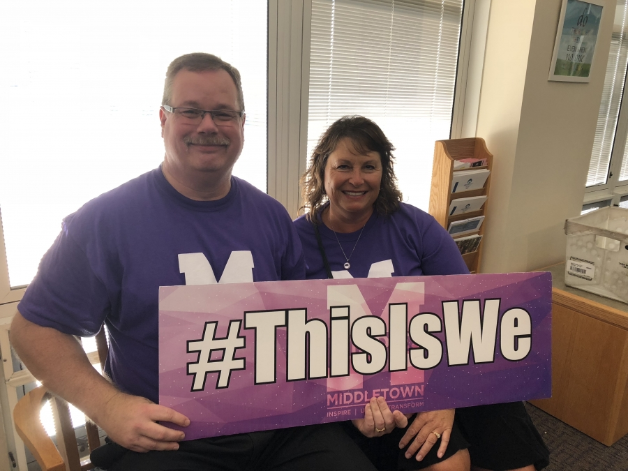 Two people holding a #ThisIsWe sign