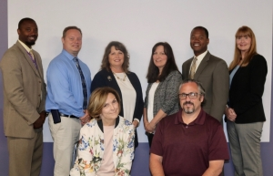(Back, L-R) Kee Edwards, principal, Michael Valenti, principal, Debbie Sander, senior director of student services, Jenny Dennis, principal, Marlon J. Styles, Jr., superintendent, Melissa Prohaska, instructional technology coordinator, (Sitting, L-R), Fran Morrison, senior director of curriculum and innovation,Craig Campbell, technology coordinator, (not pictured: Carmela Cotter, principal)