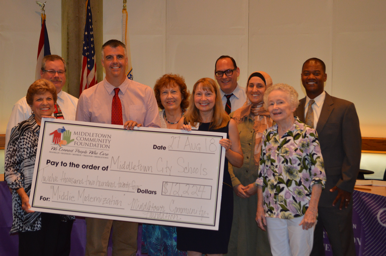 Board of Education with giant check