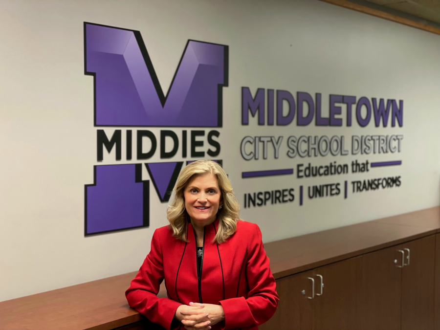 Deb Houser picture in front of MCSD logo